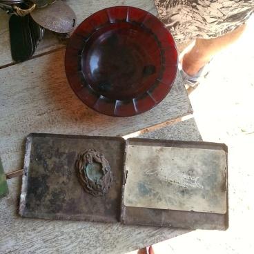 Glass ashtray, Cigarette case and brooch